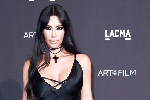(Photo by Richard Shotwell/Invision/AP, File). FILE - In this Nov. 3, 2018, file photo, Kim Kardashian West attends the 2018 LACMA Art+Film Gala at Los Angeles County Museum of Art in Los Angeles. The reality star and makeup mogul has decided to change...