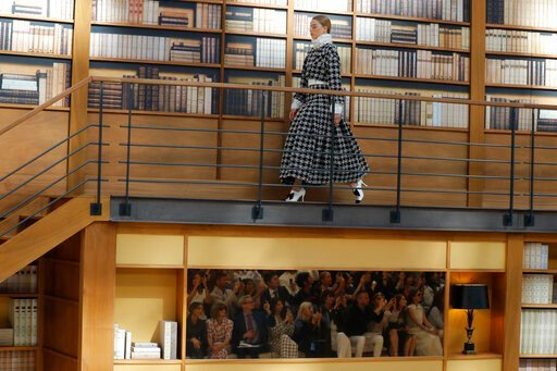 (AP Photo/Michel Euler). A model wears a creation for the Chanel Haute Couture Fall-Winter 2020 fashion collection presented in Paris, Tuesday, July 2 2019.