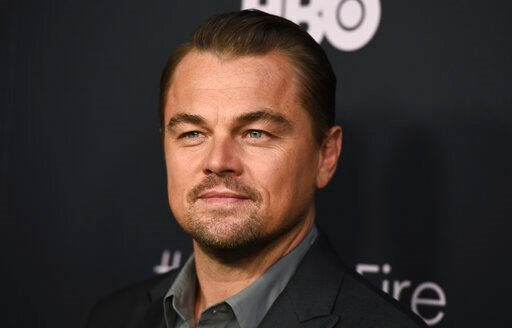"""(Photo by Jordan Strauss/Invision/AP, File). FILE - This June 5, 2019 file photo shows Leonardo DiCaprio at the premiere of """"Ice on Fire"""" in Los Angeles. DiCaprio is joining with billionaire investors and philanthropists Laurene Powell Jobs and Brian S..."""