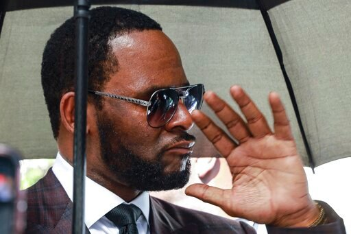 (AP Photo/Amr Alfiky, File). FILE - In this June 26, 2019, file photo, Musician R. Kelly departs from the Leighton Criminal Court building after a status hearing in his criminal sexual abuse trial in Chicago. Lawyers for Kelly are asking a judge in Chi...