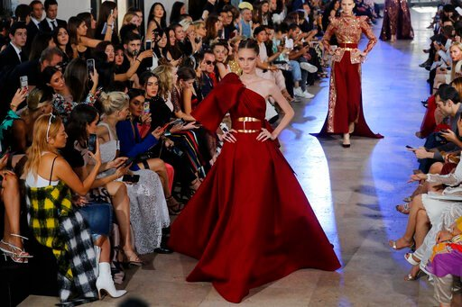 (AP Photo/Michel Euler). A model wears a creation for Elie Saab Haute Couture Fall-Winter 2019-2020 fashion collection presented, Wednesday, July 3, 2019 in Paris.