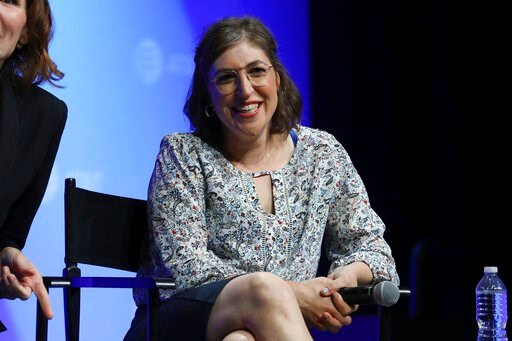"""(Photo by Mark Von Holden/Invision/AP). Mayim Bialik speaks at the AT&T's SHAPE: """"The Scully Effect is Real"""" panel with Geena Davis and Mayim Bialik on Saturday, June 22, 2019 in Burbank, Calif."""