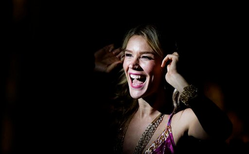 (AP Photo/Ben Curtis, File). FILE - In this Nov. 26, 2016 file photo, British singer Joss Stone laughs as she adjusts her earpiece before performing a concert in Karen, on the outskirts of Nairobi, Kenya. Stone says Wednesday, July 3, 2019, she was dep...