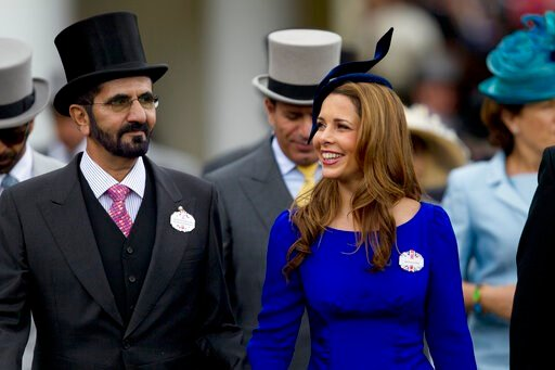 (AP Photo/Alastair Grant, File). FILE - In this Wednesday, June 20, 2012 file photo, Sheikh Mohammed Al Maktoum and his wife Princess Haya of Jordan walk towards the paddock on the second day of Royal Ascot horse race meeting at Ascot, England.  A lega...