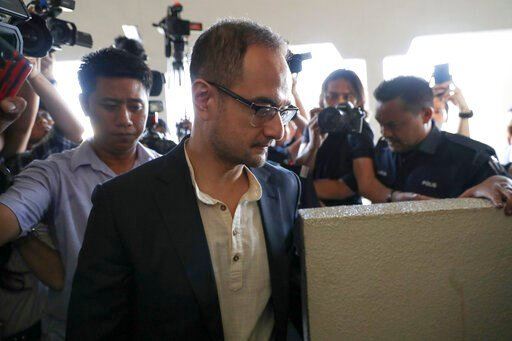 (AP Photo/Vincent Thian). Riza Aziz, stepson of Malaysian former Prime Minister Najib Razak, walks into a court room at Kuala Lumpur High Court in Kuala Lumpur, Malaysia, Friday, July 5, 2019. Malaysia's anti-graft agency said Thursday it has detained ...