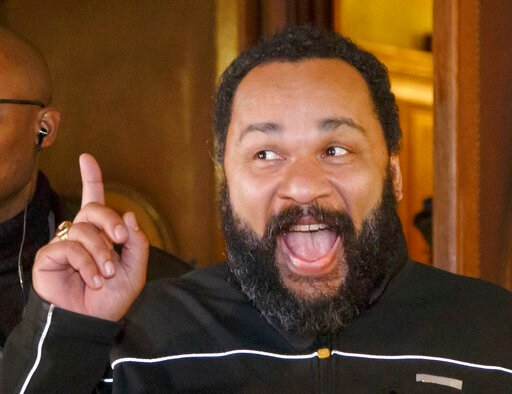 (AP Photo/Michel Euler, File). FILE - In this Feb.4, 2015 file photo, French comedian Dieudonne M'Bala M'Bala gestures to the media as he leaves a Paris court house. A French court has convicted Friday July 5, 2019 controversial comedian Dieudonne M'Ba...