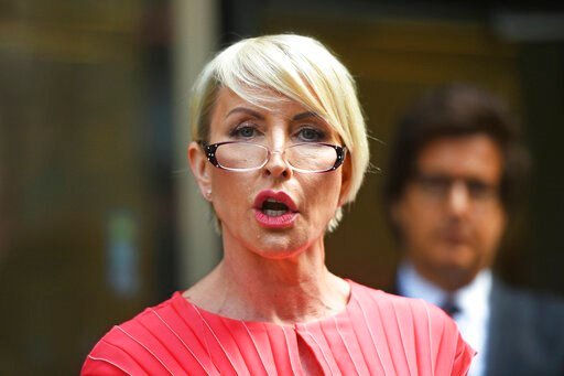 (Kirsty O'Connor/PA via AP). Heather Mills speaks outside Rolls Building at the end of her legal phone-hacking claim against News Group Newspapers, in London, Monday July 8, 2019.  Businesswoman and campaigner, Heather Mills, settled her claim Monday o...