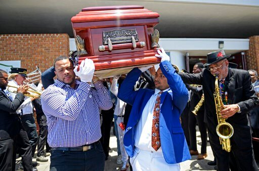 (Max Becherer/Times-Picayune via AP). Pallbearers carry the coffin of Dave Bartholomew past the Treme brass band as they exit St. Gabriel the Archangel Church at the conclusion of his funeral in New Orleans, La. Monday, July 8, 2019. The life of Dave B...
