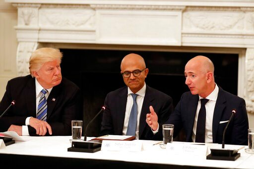 (AP Photo/Alex Brandon, File). FILE - In this June 19, 2017, file photo President Donald Trump, left, and Satya Nadella, Chief Executive Officer of Microsoft, center, listen as Jeff Bezos, Chief Executive Officer of Amazon, speaks during an American Te...