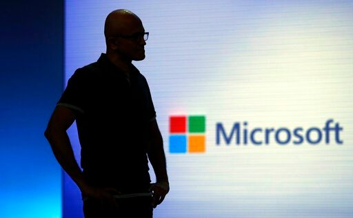 (AP Photo/Elaine Thompson, File). FILE- In this May 7, 2018, file photo Microsoft CEO Satya Nadella looks on during a video as he delivers the keynote address at Build, the company's annual conference for software developers in Seattle. Amazon and Micr...