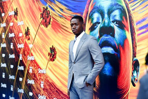 """(Photo by Chris Pizzello/Invision/AP). Damson Idris, star of the FX television series """"Snowfall,"""" poses at the third season premiere of the show, Monday, July 8, 2019, in Los Angeles."""