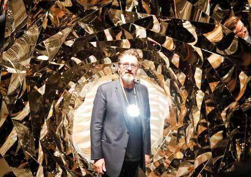 (AP Photo/Frank Augstein). Olafur Eliasson poses at the installation 'Your Spiral View' as part of the exhibition Olafur Eliasson: 'In real life' at the Tate Modern Gallery in London, Tuesday, July 9, 2019. The Tate Modern has brought together around 4...