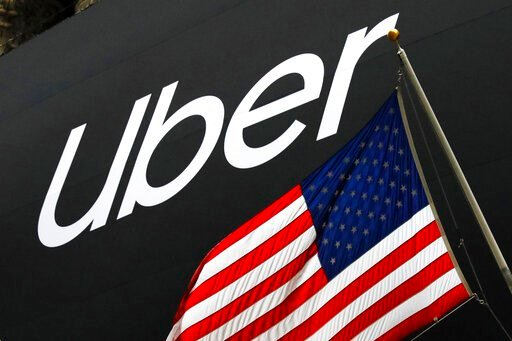 (AP Photo/Mark Lennihan, File). FILE - In this May 10, 2019, file photo a banner for Uber is draped on the front of the New York Stock Exchange before the world's largest ride-hailing service holds its initial public offering. Uber is letting passenger...