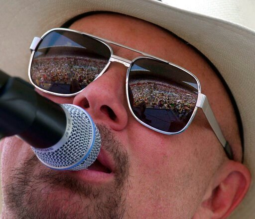 (AP Photo/Mark Humphrey). FILE - In this June 12, 2000 file photo Country music fans are reflected in the glasses of Southern rock group Confederate Railroad lead singer Danny Shirley during a concert in Nashville, Tenn. Confederate Railroad says it ha...