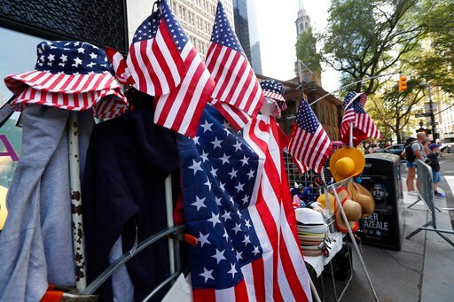 """(AP Photo/Kathy Willens). Red, white and blue flag-themed hats and other items are for sale along Broadway, also known as the """"Canyon of Champions,"""" in lower Manhattan, one day ahead of a ticker-tape parade and City Hall ceremony for the four-time Worl..."""