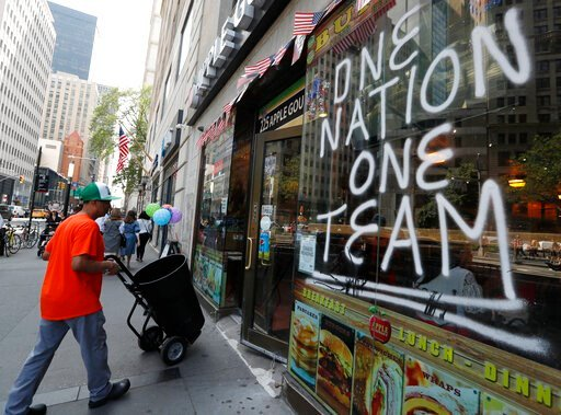 (AP Photo/Kathy Willens). A spray-painted sign honors the four-time World Cup winning U.S. women's soccer team, one day ahead of a ticker-tape parade and City Hall ceremony honoring their latest achievement, Tuesday, July 9, 2019, in New York.