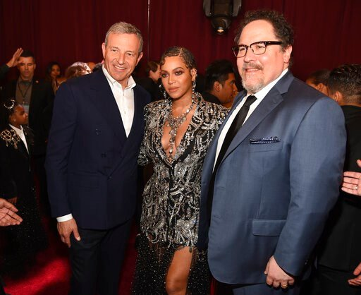 """(Photo by Chris Pizzello/Invision/AP). Bob Iger, left, chairman and CEO of The Walt Disney Company, poses with """"The Lion King"""" cast member Beyonce, center, and the film's director Jon Favreau at the premiere of the film at the El Capitan Theatre, Tuesd..."""