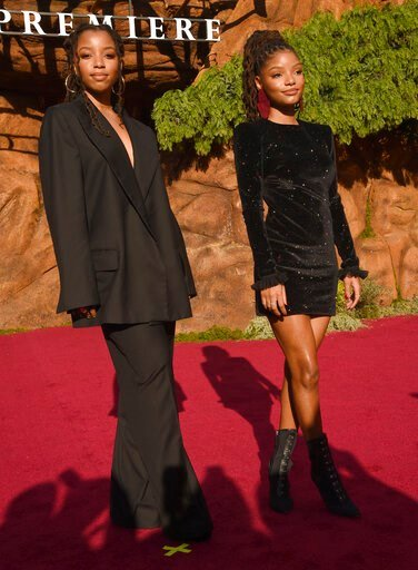 """(Photo by Chris Pizzello/Invision/AP). Chloe Bailey, left, and Halle Bailey, of Chloe X Halle, arrive at the world premiere of """"The Lion King"""" on Tuesday, July 9, 2019, at the Dolby Theatre in Los Angeles."""