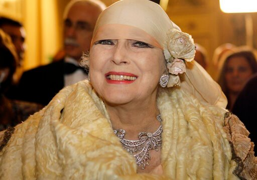 (AP Photo/Luca Bruno). FILE - In this photo taken on Dec. 7, 2007, Valentina Cortese arrives at the Milan La Scala opera house. The renown actress, who worked with some of the best directors of both theater and cinema such as Strehler, Fellini, Truffau...
