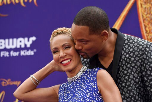 """(Photo by Chris Pizzello/Invision/AP, File). FILE - In this May 21, 2019 file photo, Will Smith, right, kisses Jada Pinkett Smith as they arrive at the premiere of """"Aladdin"""" at the El Capitan Theatre in Los Angeles. The Hollywood power couple on Wednes..."""