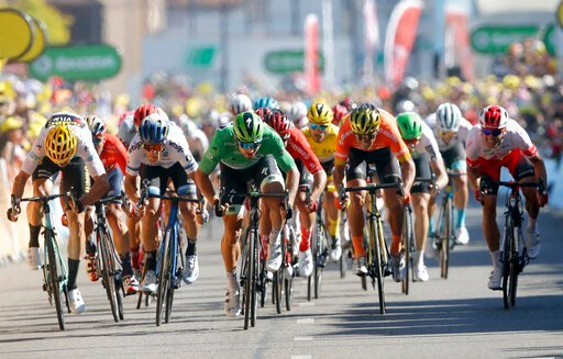(AP Photo/Christophe Ena). Riders with Slovakia's Peter Sagan wearing the best sprinter's green jersey sprint to cross the finish line during the fifth stage of the Tour de France cycling race over 175.5 kilometers (109 miles) with start in Saint-Die-D...