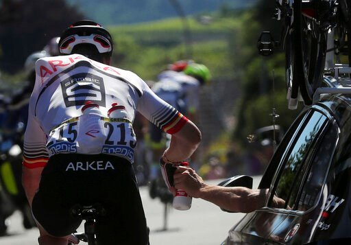 (AP Photo/Thibault Camus). Germany's Andre Greipel takes water from team director car during the fifth stage of the Tour de France cycling race over 175.5 kilometers (109 miles) with start in Saint-Die-Des-Vosges and finish in Colmar, Wednesday, July 1...