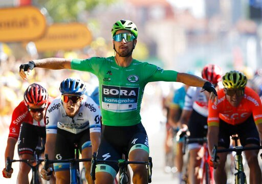 (AP Photo/Christophe Ena). Slovakia's Peter Sagan wearing the best sprinter's green jersey celebrates as he crosses the finish line to win the fifth stage of the Tour de France cycling race over 175.5 kilometers (109 miles) with start in Saint-Die-Des-...
