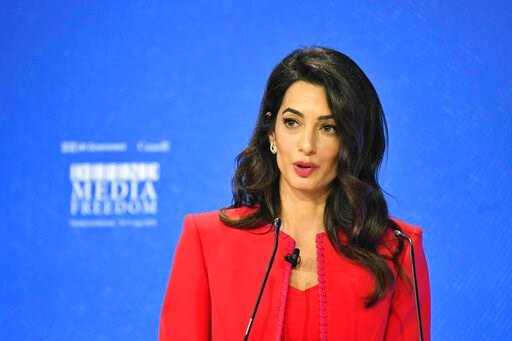 (Dominic Lipinski/PA via AP). Amal Clooney spekas during the Global Conference for Media Freedom at The Printworks in London, Wednesday, July 10, 2019.