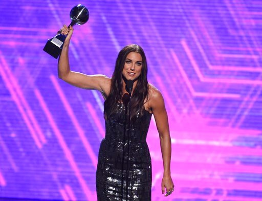 (Photo by Chris Pizzello/Invision/AP). Alex Morgan, a member of the U.S women's national soccer team, accepts the award for best female athlete at the ESPY Awards on Wednesday, July 10, 2019, at the Microsoft Theater in Los Angeles.