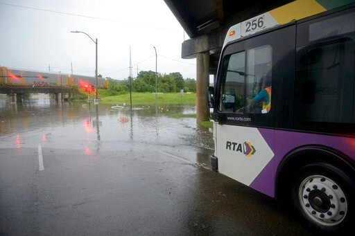 (Max Becherer/The Advocate via AP). A Regional Transport Authority bus waits out the rain at the intersection of Franklin Ave. and 610 in New Orleans where streets were flooded after a severe thunderstorm, Wednesday, July 10, 2019.