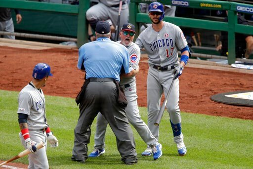 (AP Photo/Gene J. Puskar). Chicago Cubs manager Joe Maddon, center, yells toward the Pittsburgh Pirates dugout as he is restrained by umpire Joe West and Cubs' Kris Bryant (17) during the fourth inning of a baseball game in Pittsburgh, Thursday, July 4...