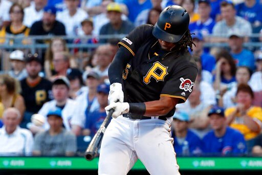 (AP Photo/Gene J. Puskar, File). FILE - In this July 1, 2019, file photo, Pittsburgh Pirates' Josh Bell hits a three-run home run off Chicago Cubs starting pitcher Adbert Alzolay during the first inning of a baseball game in Pittsburgh. Bell is among e...