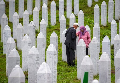 (AP Photo/Darko Bandic). Relatives of victime visit the memorial cemetery in Potocari near Srebrenica, Bosnia, Wednesday, July 10, 2019. The remains of 33 victims of Srebrenica massacre will be buried on July 11, 2019, 24 years after Serb troops overra...