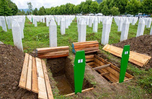 (AP Photo/Darko Bandic). Fresh graves are dug at the memorial cemetery in Potocari near Srebrenica, Bosnia, Wednesday, July 10, 2019. The remains of 33 victims of Srebrenica massacre will be buried on July 11, 2019, 24 years after Serb troops overran t...