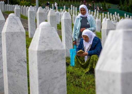 (AP Photo/Darko Bandic). Relatives of victims pray as they visit the memorial cemetery in Potocari near Srebrenica, Bosnia, Wednesday, July 10, 2019. The remains of 33 victims of Srebrenica massacre will be buried on July 11, 2019, 24 years after Serb ...