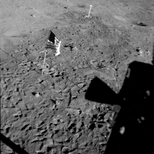 (NASA via AP). This July 21, 1969 photo made available by NASA shows the U.S. flag planted at Tranquility Base on the surface of the moon, and a silhouette of a thruster at right, seen from a window in the Lunar Module. Rather than let the flag droop, ...