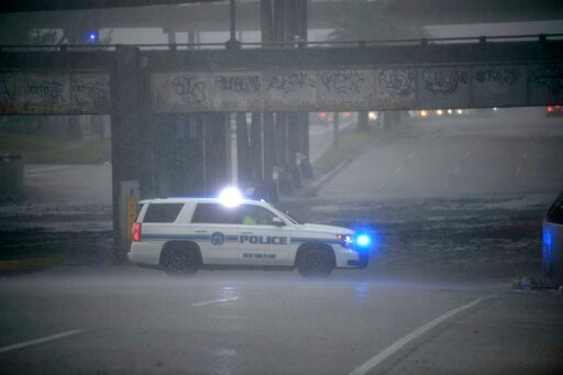 (Max Becherer/The Advocate via AP). An NOPD cruiser blocks the underpass at S. Carrollton Ave. in New Orleans as severe thunderstorms caused street flooding, Wednesday, July 10, 2019.