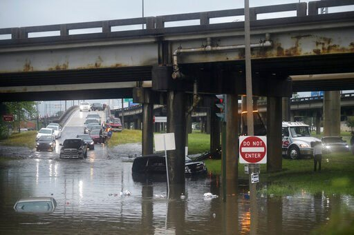 (Max Becherer/The Advocate via AP). Motorists react in New Orleans react as the intersection at Franklin Ave. and 610 floods after a severe thunderstorm Wednesday, July 10, 2019. A storm swamped streets in New Orleans and prompted a tornado warning nea...