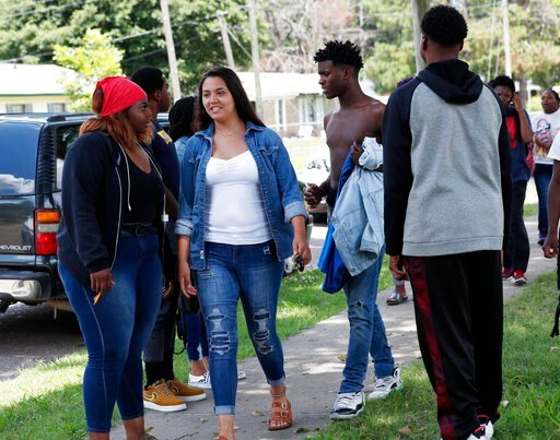 (AP Photo/Rogelio V. Solis). In this Friday, July 3, 2019 photo, an integrated group of students leave Cleveland Central Middle School after finishing up their summer school studies for the day in Cleveland Miss. After a weeklong trial in 2015, a feder...