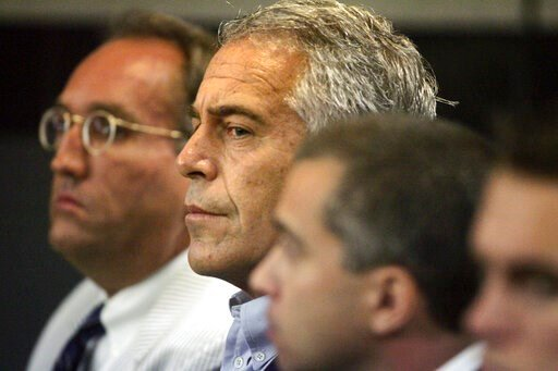 (Uma Sanghvi/Palm Beach Post via AP, File). FILE - In this July 30, 2008 file photo, Jeffrey Epstein, center, appears in court in West Palm Beach, Fla. The wealthy financier pleaded not guilty in federal court in New York on Monday, July 8, 2019, to se...