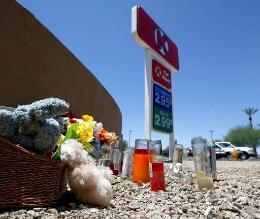 (AP Photo/Ross D. Franklin). A makeshift memorial for Elijah Al-Amin is set up at a local Circle K store for the death of the stabbing victim Tuesday, July 9, 2019, in Peoria, Ariz. Peoria police arrested 27-year-old Michael Adams on suspicion of first...