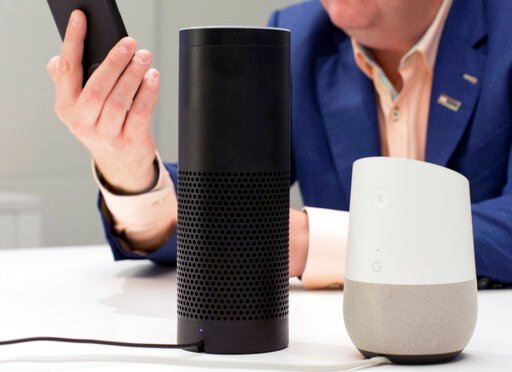 (AP Photo/Mark Lennihan, File). FILE - In this June 14, 2018, photo, an Amazon Echo, center, and a Google Home, right, are displayed in New York. Google contractors are listening to some recordings of people talking to Assistant, either on their phone ...
