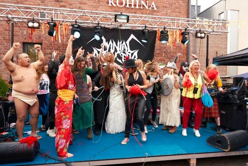 """(AP Photo/David Keyton). The competitors of the first Heavy Metal Knitting world championship react on stage, Thursday, July 11, 2019 in Joensuu, Finland. With stage names such as 'Woolfumes,' 'Bunny Bandit' and '9"""" Needles,' the goal was quite simple:..."""
