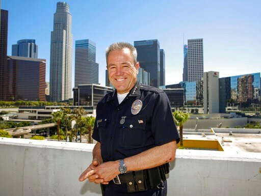 (AP Photo/Damian Dovarganes). In this Wednesday, July 10, 2019, photo Los Angeles Police Department Chief Michel Moore poses for a photo in downtown Los Angeles. The Los Angeles police chief said he hopes in the coming weeks the city will eliminate old...