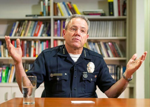(AP Photo/Damian Dovarganes). In this Wednesday, July 10, 2019, photo Los Angeles Police Department Chief Michel Moore talks during an interview with The Associated Press in Los Angeles. Moore said he doesn't see homelessness as a law enforcement issue...
