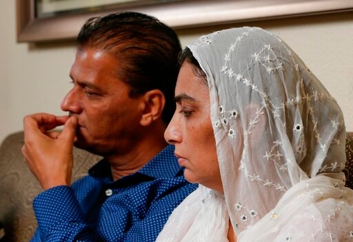 (AP Photo/Michael Wyke). In this Wednesday July 10, 2019 photo, Abdul Aziz, left, and his wife Farah Naz, the parents of Santa Fe High School shooting victim Sabika Aziz Sheikh, 17,  talk about the impact of Sabika's death during an interview at their ...
