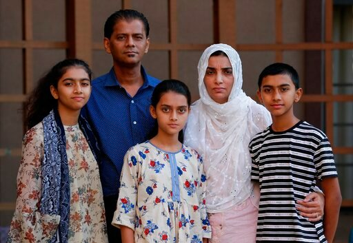 (AP Photo/Michael Wyke). In this Wednesday July 10, 2019 photo, family members of Santa Fe High School shooting victim Sabika Aziz Sheikh, 17, pose at their home during an interview in Houston., They are, from left, sister Sonia Aziz Sheikh, 15, Abdul ...