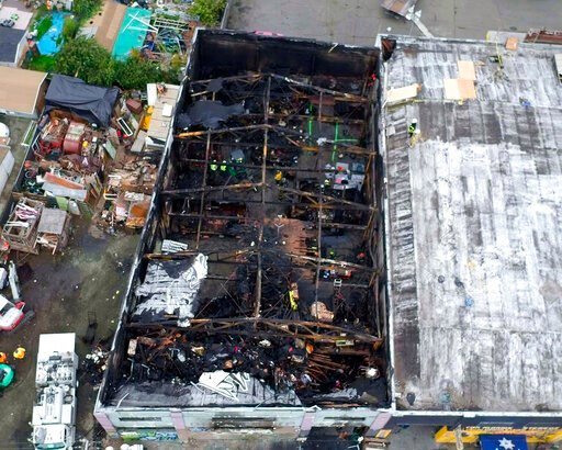 (City of Oakland via AP, File). FILE - This undated file photo provided by the City of Oakland shows the burned warehouse after the deadly fire that broke out on Dec. 2, 2016, in Oakland, Calif. Derick Almena, the founder of a California communal livin...