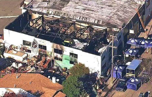 (KGO-TV via AP, File). FILE - This Dec. 3, 2016, file image from video provided by KGO-TV shows the Ghost Ship Warehouse after a fire swept through the building in Oakland, Calif. Derick Almena, the founder of a California communal living warehouse whe...
