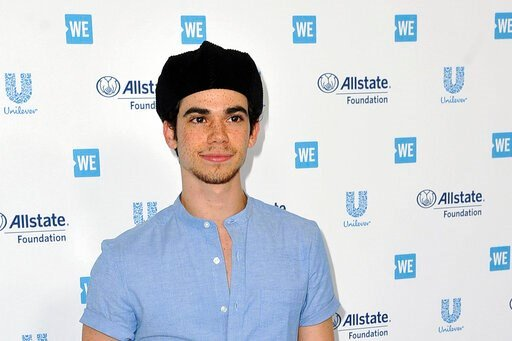 """(Photo by Richard Shotwell/Invision/AP, File). FILE - In this April 25, 2019, file photo, Cameron Boyce arrives at WE Day California at The Forum in Inglewood, Calif. Actor Cameron Boyce, known for his roles in the Disney Channel franchise """"Descendants..."""